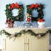Square Wreaths  Stand out this season by creating wreaths that mimic other shapes, such as this rectangular buffet. These boxwood wreaths are topped with dramatic red bows and decorated with small gold ornaments secured with floral wire.