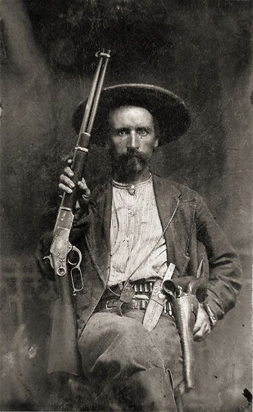 "We love this image of James B. ""Jim"" Hawkins, a charter member of Company D of the Texas Rangers, because he definitely looks like he's loaded for bear.:"