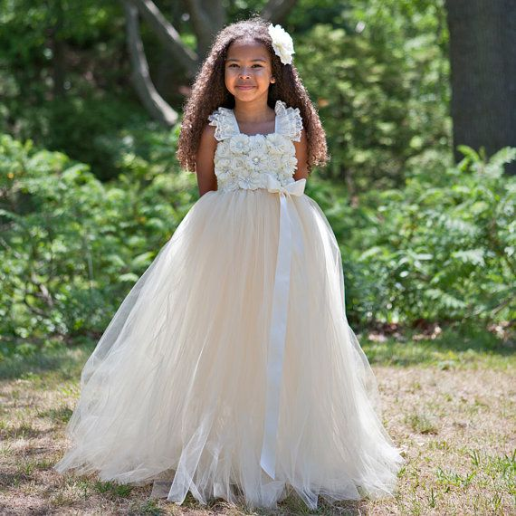 This gorgeous flower girl dress is made with 2 layers of the finest North American tulle strips. It is the perfect dress for a flower girl,