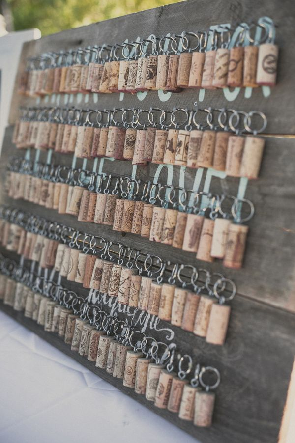 wine cork key chain favors for a vineyard wedding, photo by Next to Me Studios http://ruffledblog.com/seafoam-california-wedding #winery #weddingideas #weddingfavor