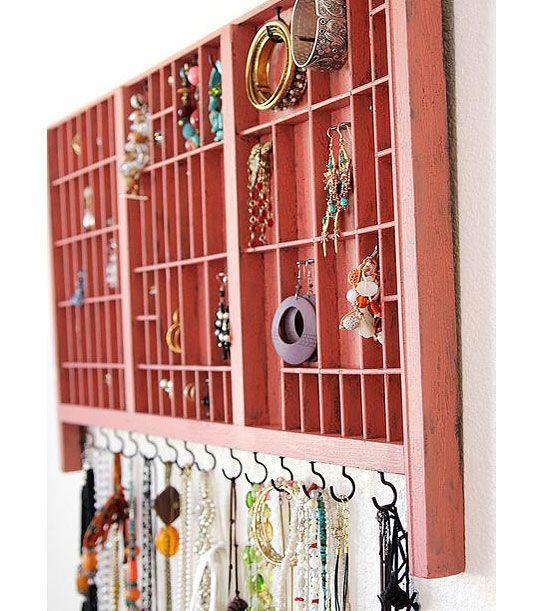 Upcycle a vintage tray into a trinket or jewelry display cabinet.