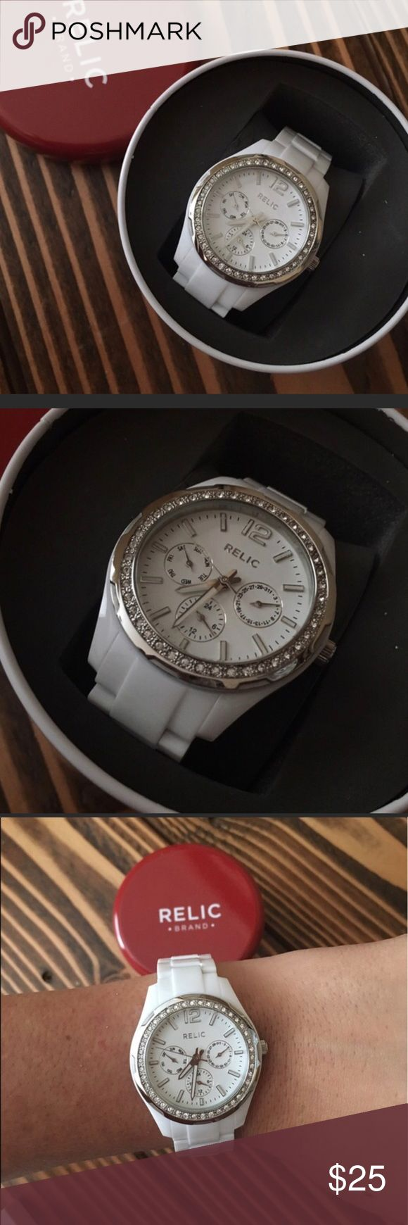 White relic watch Great condition!! White watch barely worn and looks brand new. It has diamonds around the face. Only flaw is the battery died and the case has a small dent (I posted a photo). The battery worked and someone purchased the watch from me and they said when it arrived the battery was dead. Then they mailed me back the watch with a dented case :/ but changing the battery is an easy fix :) Relic Accessories Watches