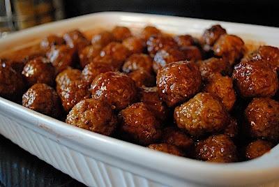 Grape Jelly Meatballs - YUMMY!  Crock pot, 1 large bag Costco frozen meatballs, 12oz grape jelly and 24oz sweet chili sauce.