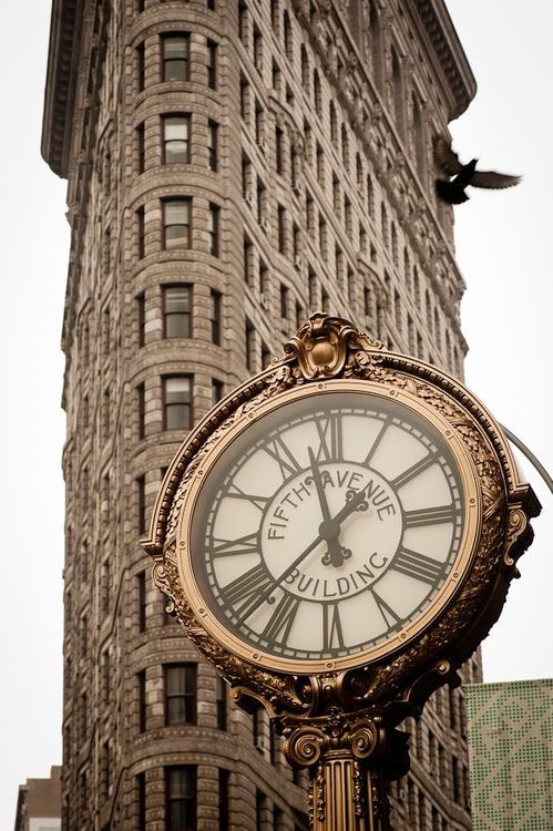"American Gilded Age era, ""Fifth Avenue Building"", clock, c.1909. Located in front of the Flatiron Building, NYC.  The clock was restored in c.2009, and that restoration was carried out by, www.electrictime.com, and sponsored by, Tiffany & Co. ~~ {cwl} ~~ (tumblr)"