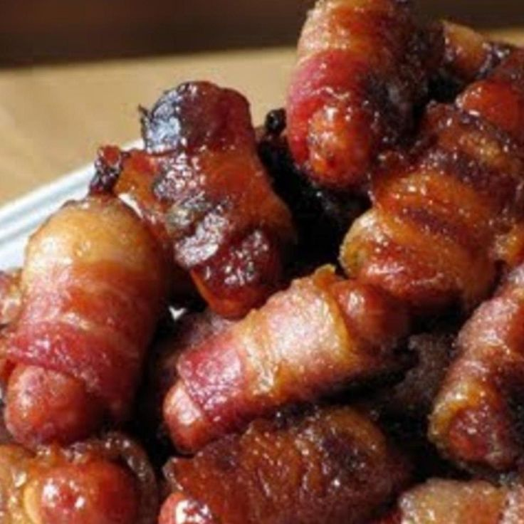 Weird title. But oh so good! Lil smokies wrapped in bacon glazed with a brown sugar mixture and baked til browned! These little piggies are perfect for parties and get-togethers and I guarantee these simple little bites of heaven (or hell if your on a diet) will be a winner with everyone as these are soooo addicting! These run out fast so be sure to double the recipe! Enjoy!