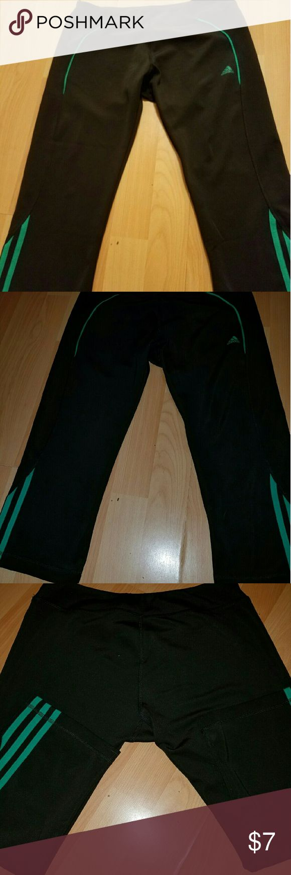 Adidas work out yoga pant Since large Adidas work out pants cropped style black with green stripes.  Good condition. Adidas Pants Track Pants & Joggers