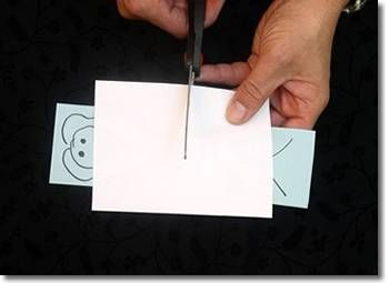 Sawing a Lady inHalf Trick. Materials: 1) paper, 2) marking pen, 3) an envelope and 3) scissors.