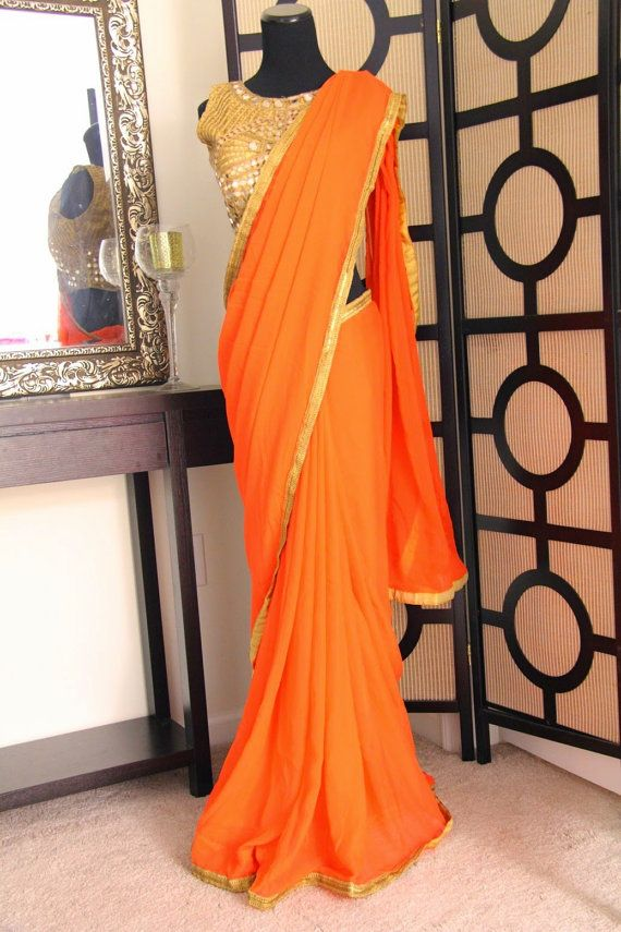 Orange silk chiffon saree with gold tissue cut work by Brioka