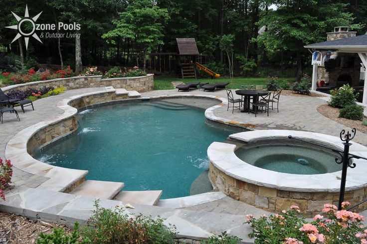 Freeform Pool/Spa with Stone Retaining Wall