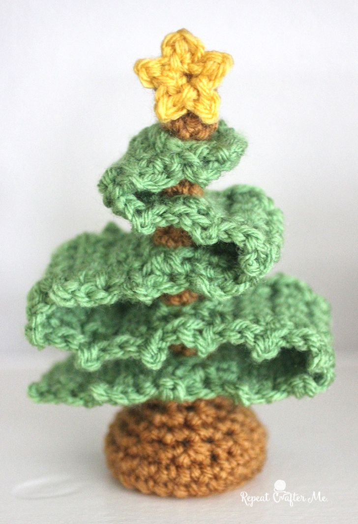 This 3D crochet Christmas Treelooked better in my mind but Ithought I would go ahead and post the pattern anyway 🙂 I figured you guys could add to it… maybetiny yarn ball ornaments, pom-poms, or maybe even a little crochet tree skirt? Make it a fun piece to include with your holiday decor! It works …