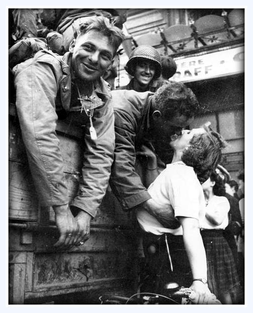 #1940s An American soldier receives a #kiss in gratitude for the liberation of Paris during World #War II. August 25, 1944