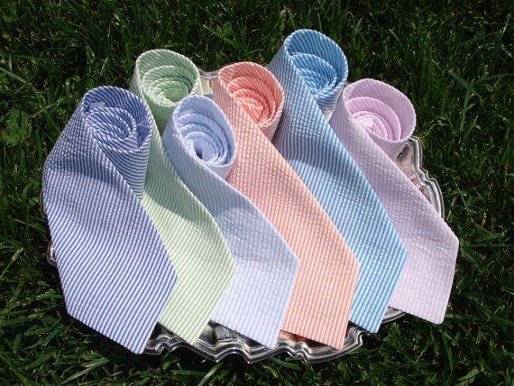 The Groomsmen are wearing these Seersucker Ties in orange - monogrammed on the back by mercystreams on Etsy, $25.00