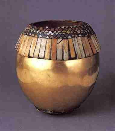 Could use an ostrich egg painted gold, and beads, to give this effect