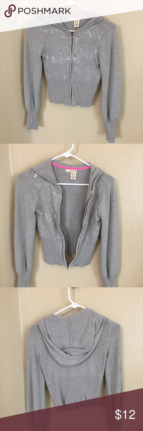 Grey DKNY zip up hoody Extra small DKNY zip up hoody. In good condition. Has some metallic lettering on front, hard to see in picture DKNY Sweaters