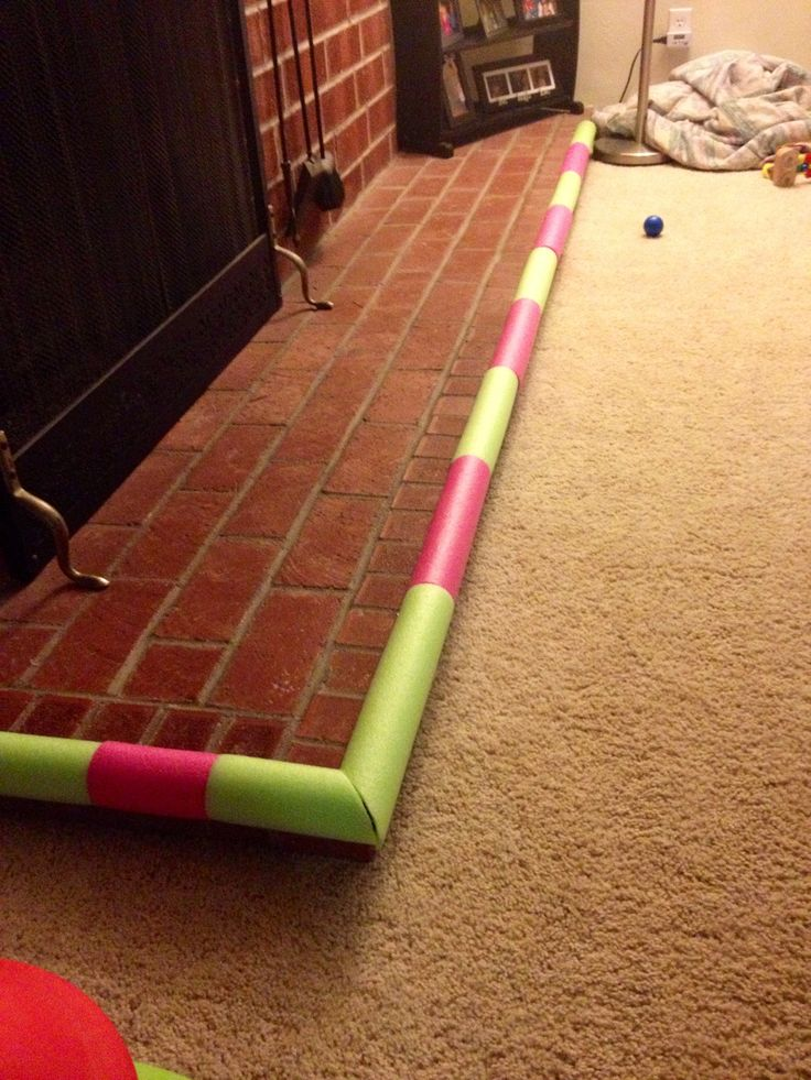 Baby bumper made from pool noodles and self stick Velcro!
