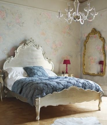 Wall Papered walls- Dramatic Bed-Aged Mirror- Simple Chandelier (perfect)