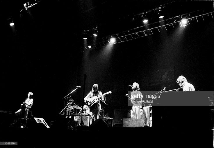 Genesis perform on stage, London, 1976, L-R Steve Hackett, Mike Rutherford, Phil Collins, Tony Banks.