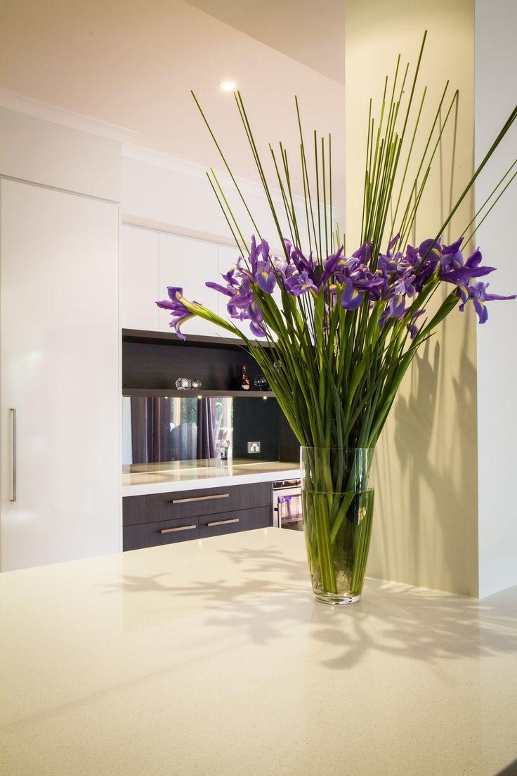 White modern kitchen. Stone benchtop. www.thekitchendesigncentre.com.au