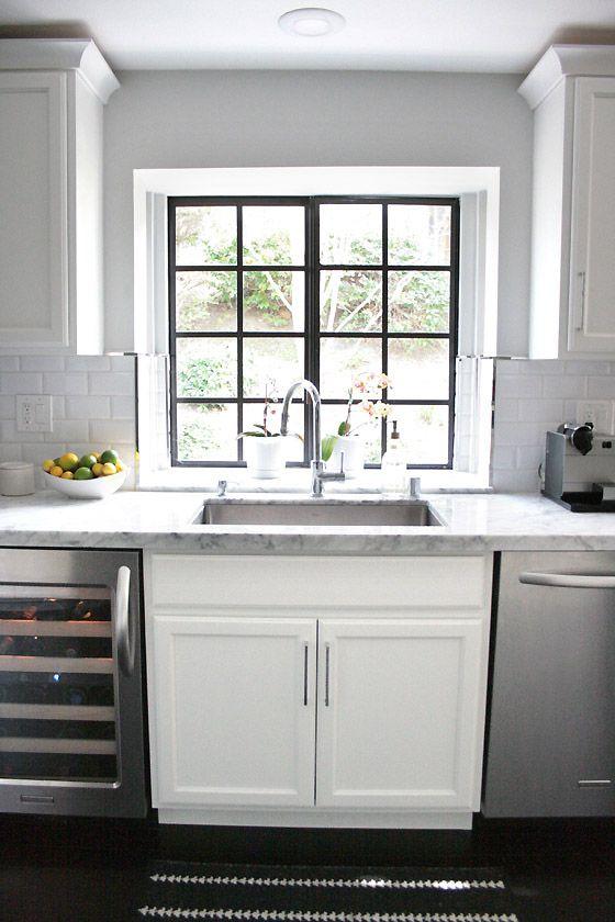 small shop Erika Brechtel white kitchen carrera marble subway tile backsplash black frame window