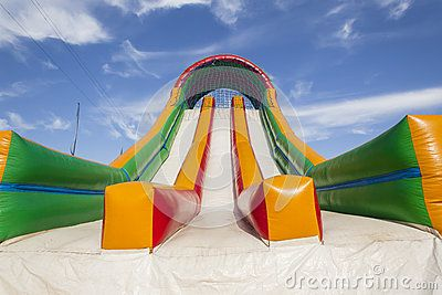 Striking canvas colors closeup of playground inflatable air slide apparatus at holiday mobile venue.