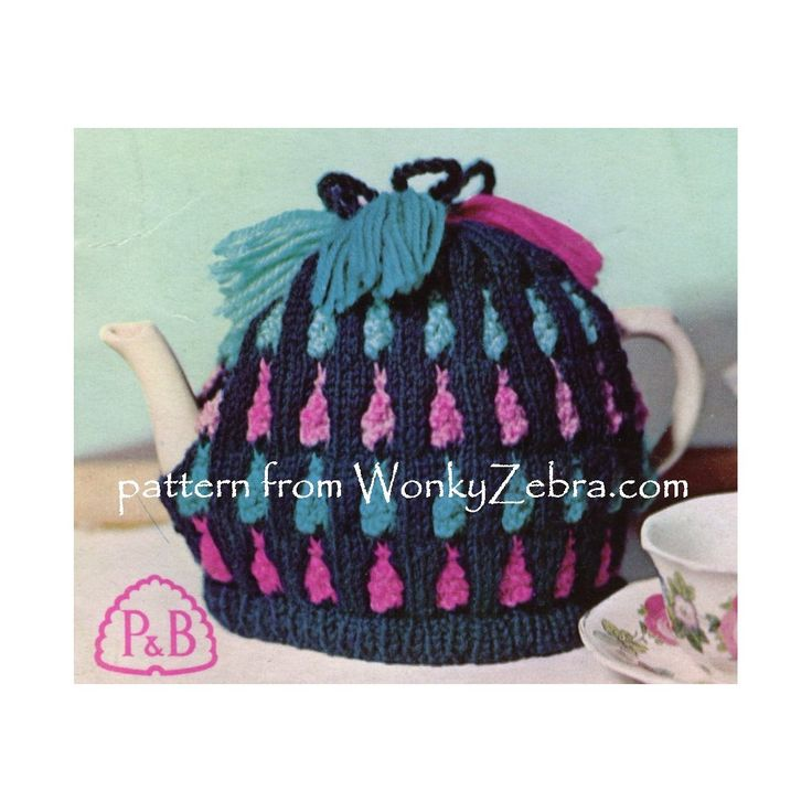 """WZ906 warm textured tea cosy to knnit with """"bells"""" (bobbles) and tassels in bright colours. Pattern PDF includes alternative crinoline style too."""