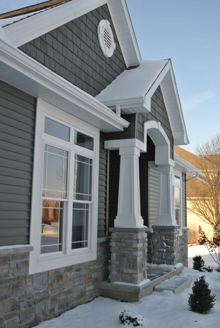 Exterior: Exterior Stoned Wainscot And Front Entry Pillars Hampton Gray Ridgestone J&N Stone