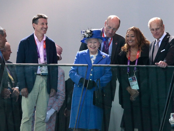 Lord Sebastian Coe (L), Chairman of the London Organising Committee of the Olympic Games stands with Queen Elizabeth II (C) and Prince Philip, Duke of Edinburgh as they attend the morning competition of the swimming on Day One of the London 2012 Olympic Games at the Aquatics Centre on July 28, 2012 in London, England.