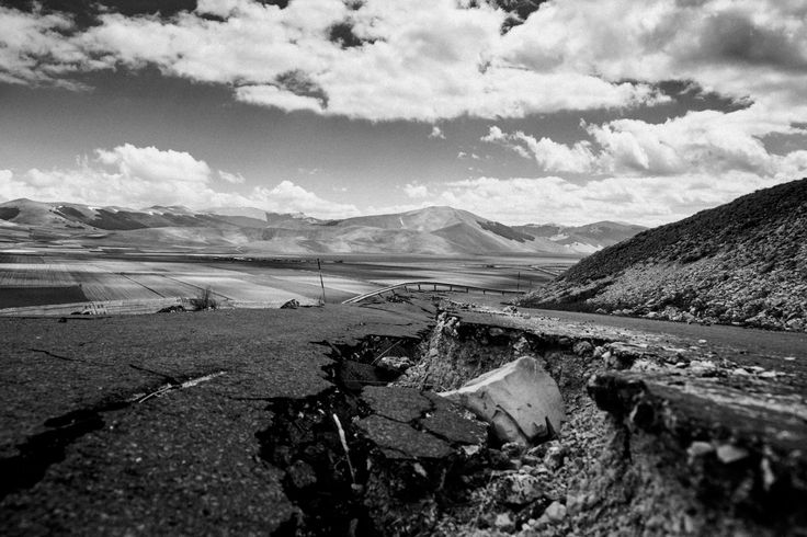Castelluccio di Norcia (PG) Italy. The road to the town of Castelluccio was severely damages by the two earthquakes of August and October 2016. The area of Castelluccio is currently closed and it's forbidden to enter without a permit from the authorities. http://ift.tt/2mBfzxo #reportage #blackandwhite #Italy #castelluccio #earthquake #aftermath #destruction #umbria  #photooftheday #photojournalism #picoftheday #igersitalia