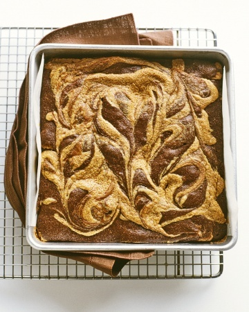Peanut-Butter Swirl Brownies... Dollops of peanut butter filling are spooned onto brownie batter; pulling a knife back and forth through both results in a marbleized look