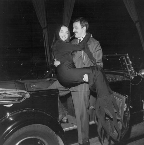 """John Astin and Carolyn Jones of """"The Addams Family""""--even when he's not in character, the way he looks at her is just adorable. <3"""