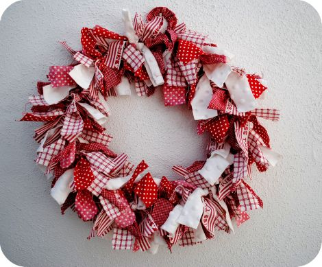 Easy wreath made using a wire hanger and strips of fabric.  Can be made for any holiday or event based on which fabric you choose.  I'm planning on getting various baseball fabrics to make a baseball theme wreath for an upcoming party.