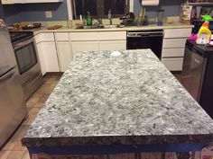 Old, ugly, laminate countertops painted to look like faux granite stone countertops. An easy and cheap affordable alternative compared to a full remodel. Tutorial on this website. All you need is acrylic paint, plastic bag, and Environtex Lite varnish. Worth a try!