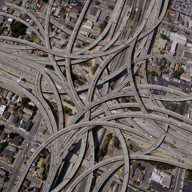 """""""Complex-Freeway-Interchange-Network"""" by john lund, Sausalito, CA // An aerial view of an incredibly complex freeway interchange and cloverleaf. This falls under the category of conceptual landscape and can be used to depict transportation, communication, connection, Internet, world wide web and even neurological issues. This is the... // Imagekind.com -- Buy stunning, museum-quality fine art prints, framed prints, and canvas prints directly from independent working artists and…"""