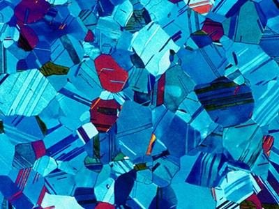 Petra Lutze    Dresden University of Technology  Dresden, Germany    Section of a coin (63x)    Polarized light - Learn more
