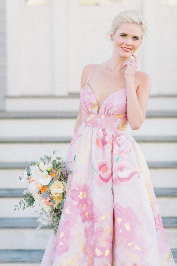 Kate McDonald Bridal: http://www.stylemepretty.com/2015/06/29/7-watercolor-wedding-dresses-that-wow/