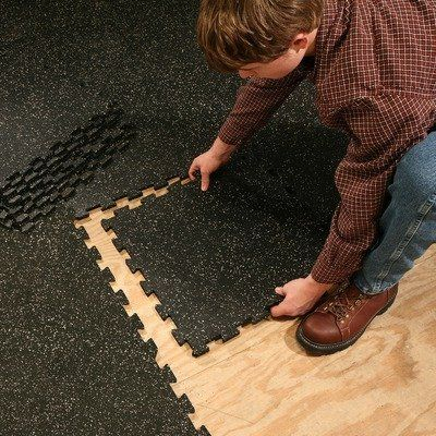 "4 Piece Interlocking Mat Black Black by Body Solid. Save 25 Off!. $42.04. No weight is too heavy for this is the heavy duty, interlocking rubber flooring system!?The SuperLock Flooring System is made from recycled rubber and bond with urethane binder which encapsulates each piece of rubber for long life and provides resistance to foreign substances. Each piece has a dimension of 19.5"" square once tabs are trimmed and two pieces snapped together measure 39"".?The Super Lock Floori..."