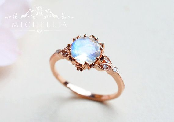 「Daphne」 Note: Last picture shows the ring in 14K White Gold and matching leaf wedding band – the band needs to be purchased separately and is NOT included in this listing price. Inspired by the Greek Laurel Tree Goddess Daphne, this vintage-inspired moonstone engagement ring combines the elements of Art Nouveau and an elegant modern touch. Made in your choice of 14K or 18K solid gold with genuine diamonds. Main Stone: Natual Moonstone, faceted cut, 7mm*7mm Accent Stone: Genuine diamonds, …