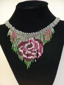 Hand beaded rose necklace. It has been double string with 40 wt. poly thread to insure that it doesn't break easily when you wear it.