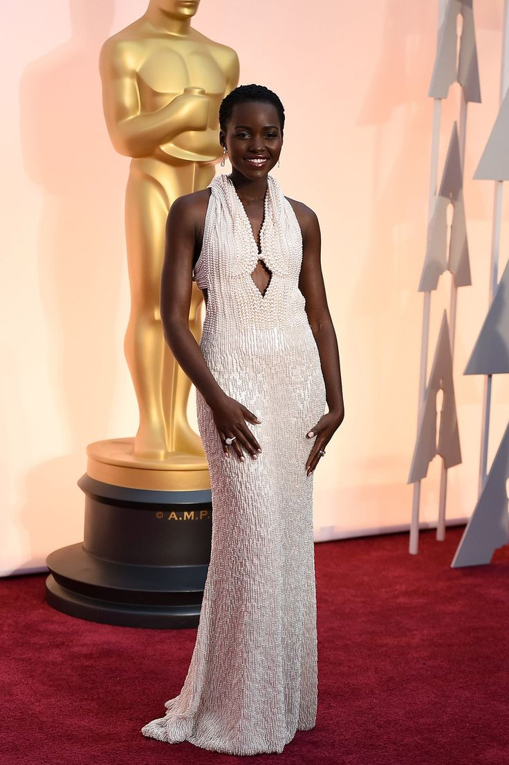 Lupita Nyong'o is wearing custom Calvin Klein on the Oscars 2015 red carpet