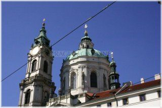 Prague 1 - bell tower and St..  Nicholas,Baroque bell tower, which served also as a fire watchtower and the seat of the night watchman, was indeed built along with ST. Nicholas, but most of it was built after the completion of the temple. The building was designed and built by the famous Baroque architect Kilian Ignaz Dienzenhofer. The tower construction was completed already in 1752, although the official end date works to the year 1755
