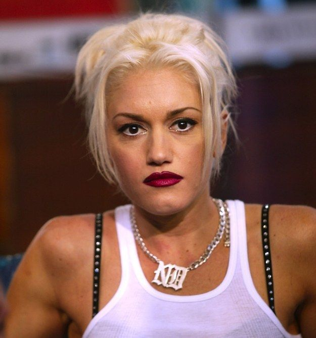 And that Old English font is great for jewelry too: | 24 Times Gwen Stefani Proved That She Is Chola Glamour Personified