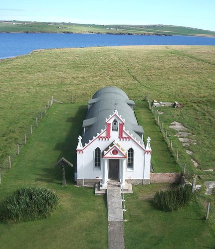 The Italian Chapel, Isle of Orkney, Scotland. This chapel was built by Italian prisoners of war using any available cheap material, inside paintings of the Virgin Mary  and plasterwork mimics the incredible Italian cathedrals.