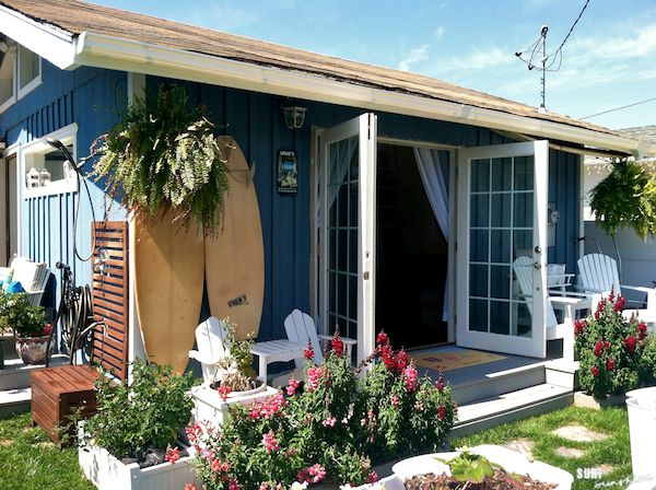 Cute little beach cottage with outdoor shower and flowers