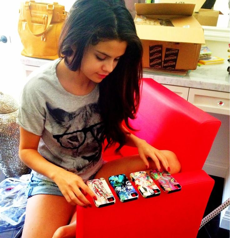 Selena Gomez trying to figure out what phone case to use for the KCA awards
