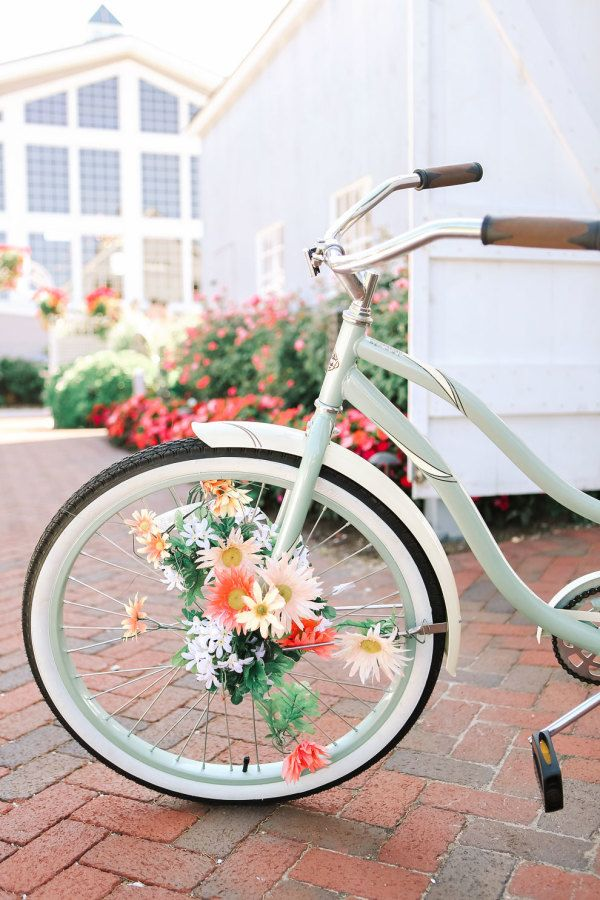 Floral accented beach cruiser: http://www.stylemepretty.com/new-jersey-weddings/2016/01/11/glamorous-private-estate-beach-wedding/ | Photography: Kay English - http://www.kayenglishphotography.com/