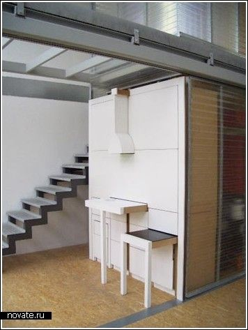 Table and benches pull out when needed. Overhead light adjusts to table, other areas are storage. Stealthy! Site is in Russian. | Tiny Homes