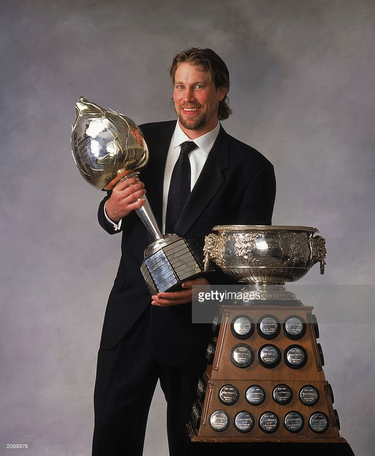 Peter Forsberg of the Colorado Avalanche poses with the Art Ross Trophy and Hart Memorial Trophy during the 2002-03 NHL Awards at the Convention Centre on June 12, 2003 in Toronto, Ontario.