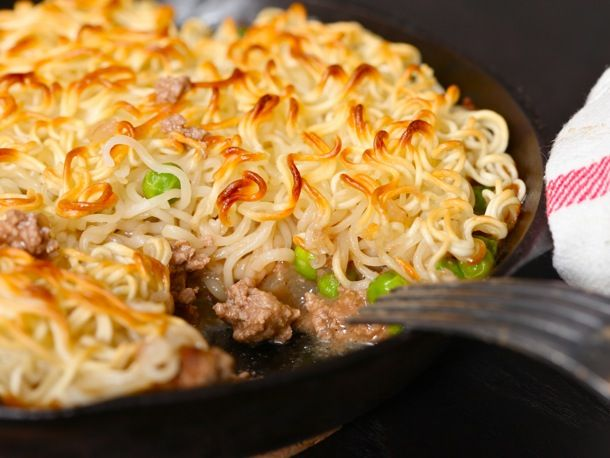 Ramen-Shepherds pie:  Start by cooking a half pound of ground beef in a large skillet with a bit of oil. Add a half cup of chopped onion along with half of the seasoning packet and a bit of water. Add some frozen peas, season to taste with salt and pepper, then transfer to a pie plate, a gratin dish, or a cast iron skillet. Top with cooked ramen noodles, then broil until brown and crispy on top.