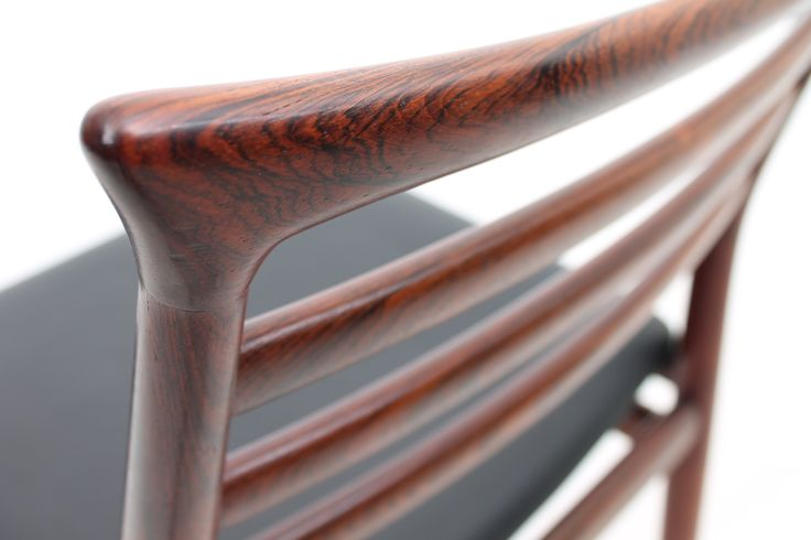 Chair in rosewood and black leather seat. Designed by Erling Torvits and produced in 1964 by Sorø møbelfabrik, Denmark.