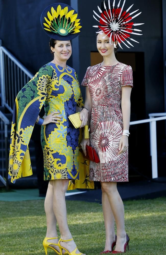 Fashion in the Field mother and daughter entrants Jo Moo and Cloe Moo from Darwin wearing Raw Cloth designs.  BOLD, colourful and fun has been the brief for the fashion flock at Flemington for the iconic Melbourne Cup.
